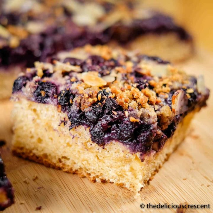 A piece of German blueberry kuchen served on a plate.