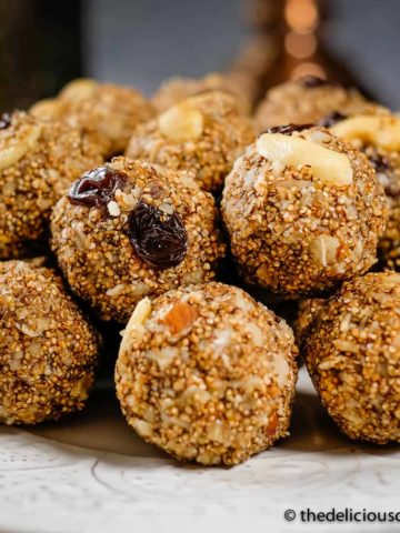 Amaranth energy balls with dates served on a plate.