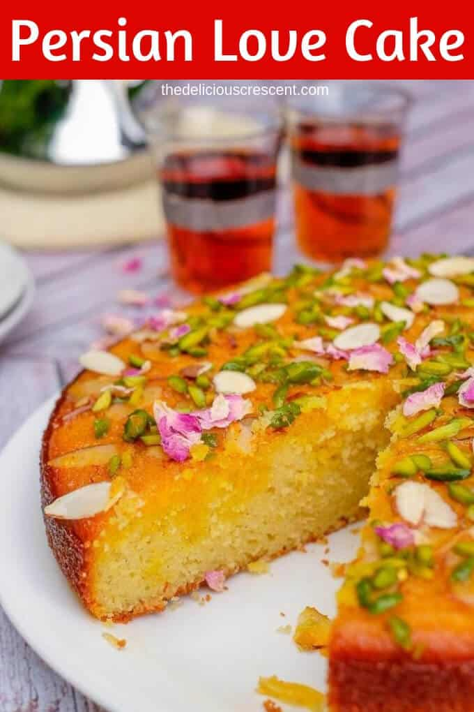 Persian love cake is moist, spongy and will enchant you with its exotic flavors of rose, cardamom, saffron. Luxuriously packed with almonds and sprinkled with pistachios, it is so easy to make! Great recipe for a traditional dessert to serve for wedding party or Valentines day. This Persian almond cake with cardamom and pistachios soaked in honey works well with rose water whipped cream. Gluten free and nut free options. #cake #dessert #Persian #rosecake #almondflour #pistachios #vegetarian