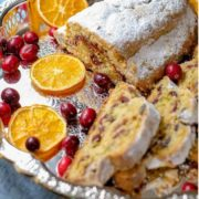 Cranberry orange quark stollen, sliced and served on a serving platter.