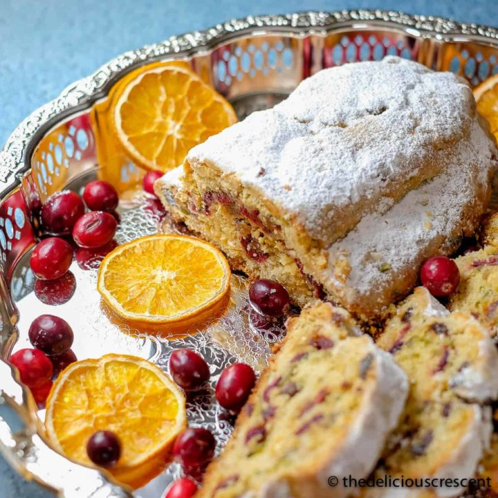 Cranberry orange quark stollen served on a platter.