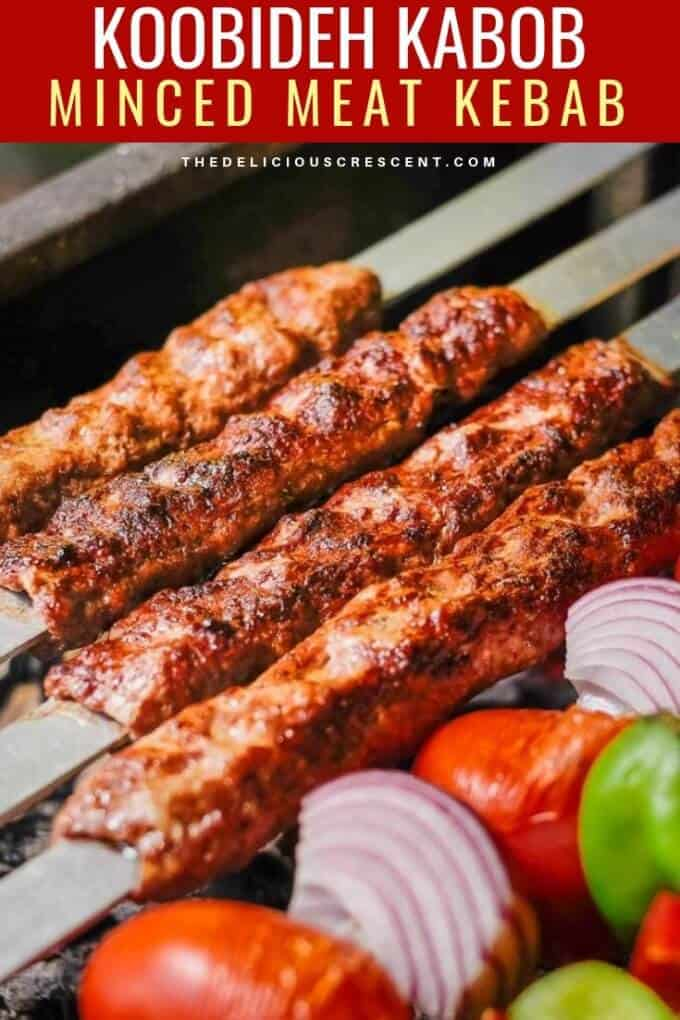 Kabob koobideh made with ground beef, ground lamb, grated onions, shaped on wide skewers and grilling to perfection.