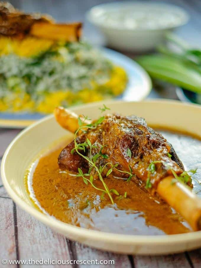 Lamb shanks braised in an amazing Persian sauce and served in a round dish with rice and yogurt salad.