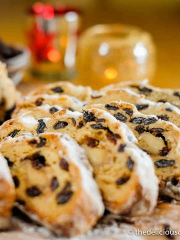 Classic German stollen sliced and served on a wooden board.