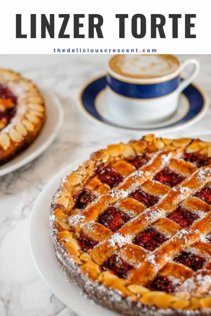 Linzer torte is a nutty, crumbly, rich pastry filled with jam and is as enchantingly pretty as it is tasty. It is easier than you would expect and delicious to the last bite! Perfect for entertaining. This dessert recipe is a specialty of Germany, Austria etc and is filled with raspberry jam and popular for holiday baking. Including suggestions for gluten free and dairy free options. #holidaybaking #torte #dessert.