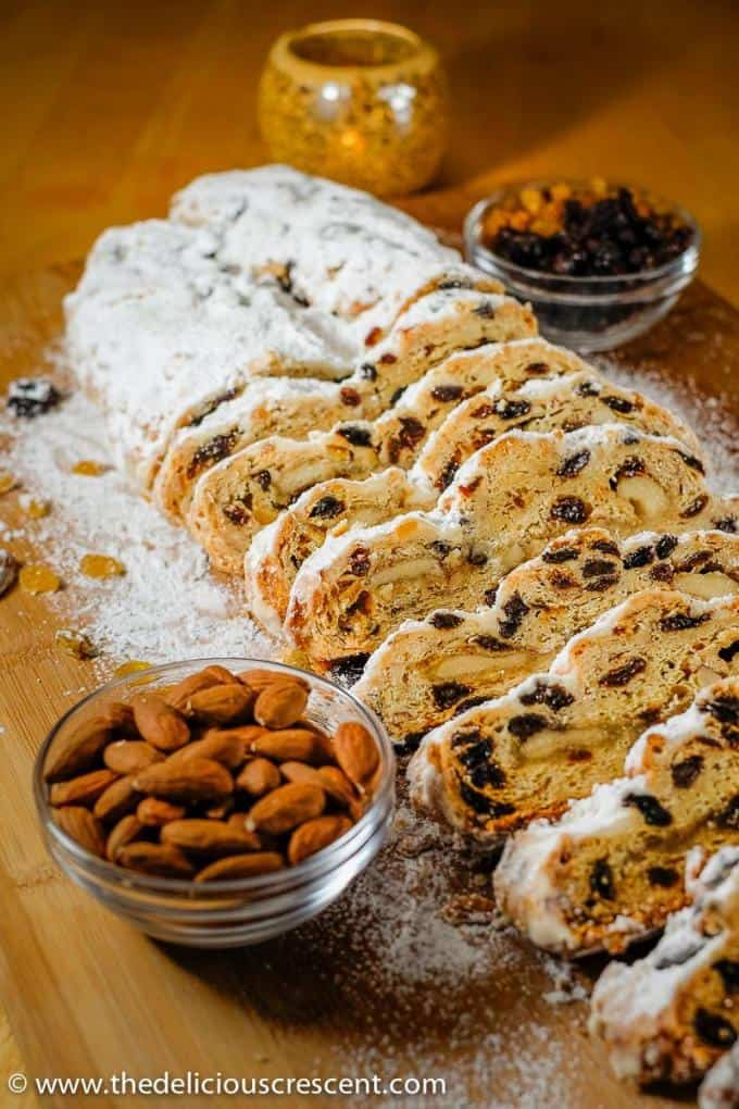 A German stollen sliced and placed on a table.
