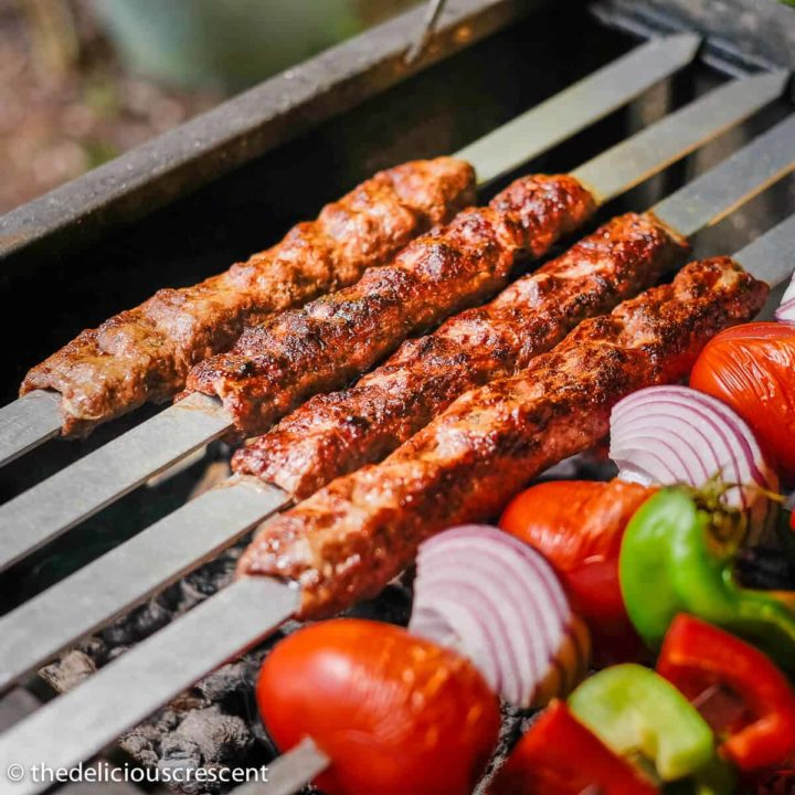 Kabob koobideh grilling to perfection over charcoal.