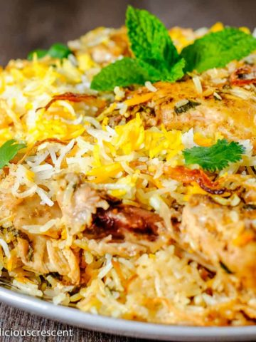 Chicken biryani served in a plate.