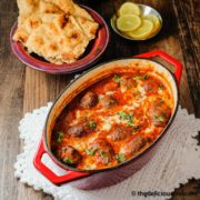 Meatball curry (kofta curry) served in a cast iron dish.