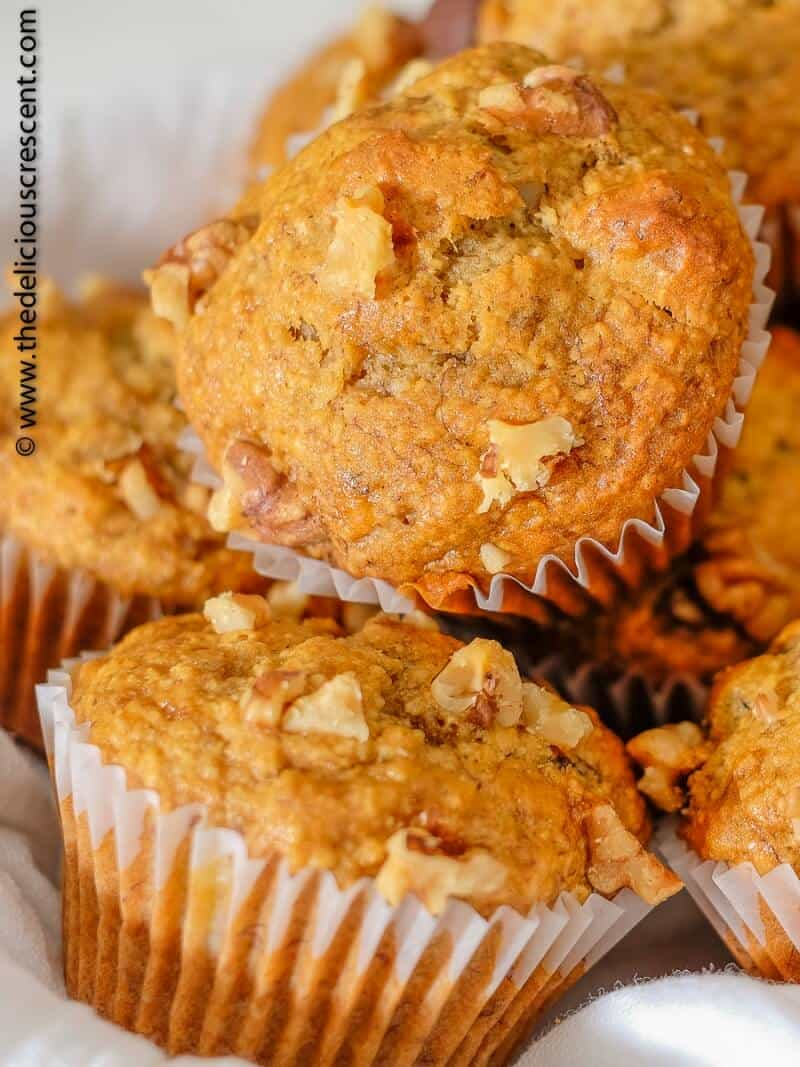 Close up view of oatmeal banana bread muffins stacked on each other.