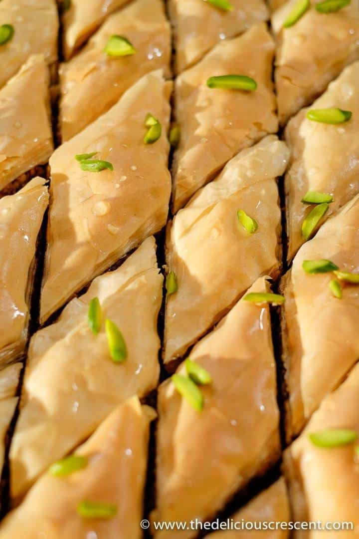 Close up view of baklava pasty after adding the syrup.