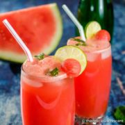 Watermelon juice with mint and lime slices served in glasses.