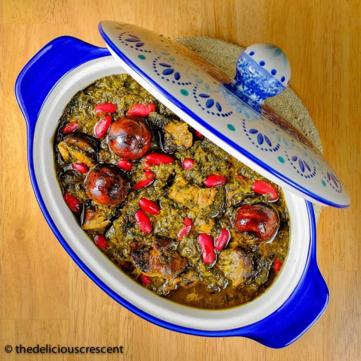 Ghormeh sabzi (Persian Herb Stew) served in a blue dish.