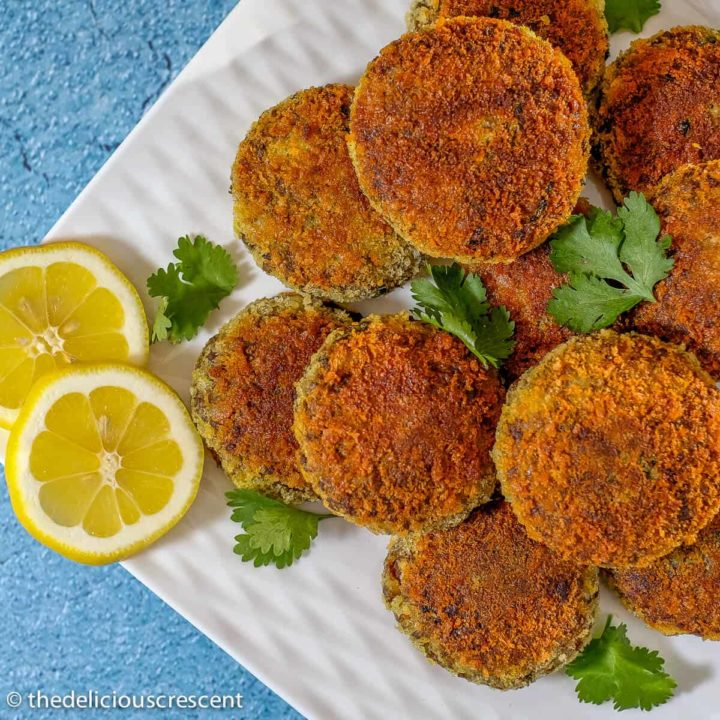 Meat patties arranged on a serving plate.