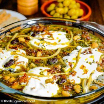 Ash-e reshteh served in a bowl..