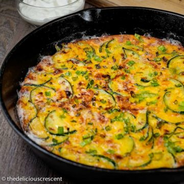 Persian zucchini frittata baked in a cast iron skillet.