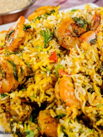 Persian shrimp and rice served on a white plate.