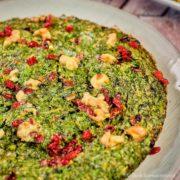 Kuku Sabzi (Persian Herb Frittata) served on a plate.