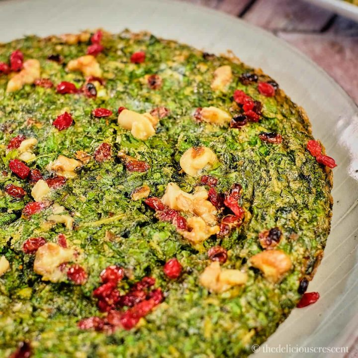 Kuku Sabzi (Persian Herb Frittata) served on a plate.