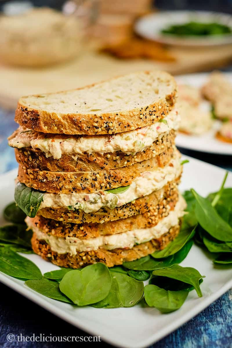 Close up view of a stack of tuna sandwiches made with chipotle.