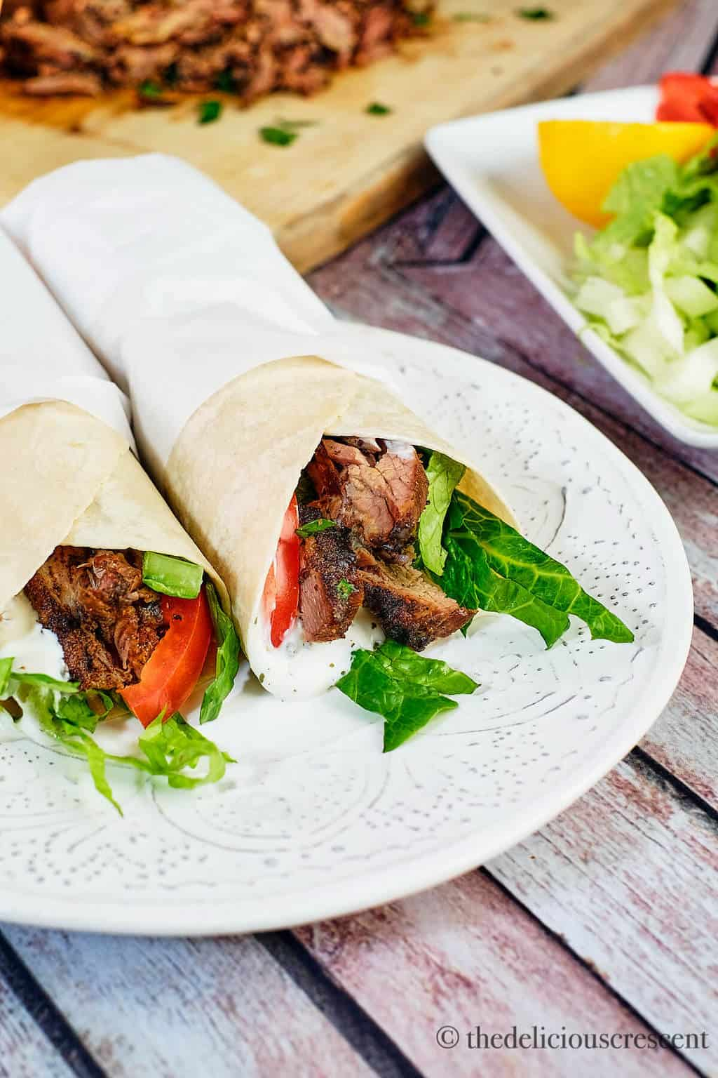 Close up view of wraps with roasted meat and vegetables.