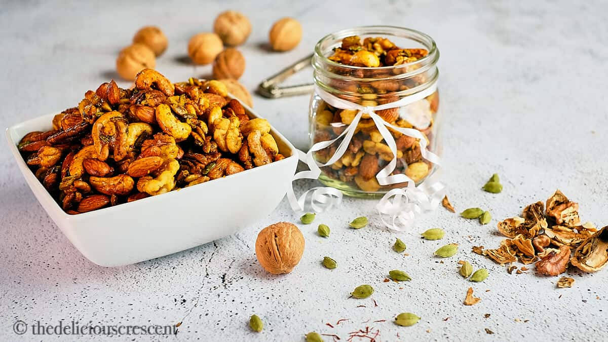 A distant view of spiced and roasted almonds, cashews, pecans and walnuts.