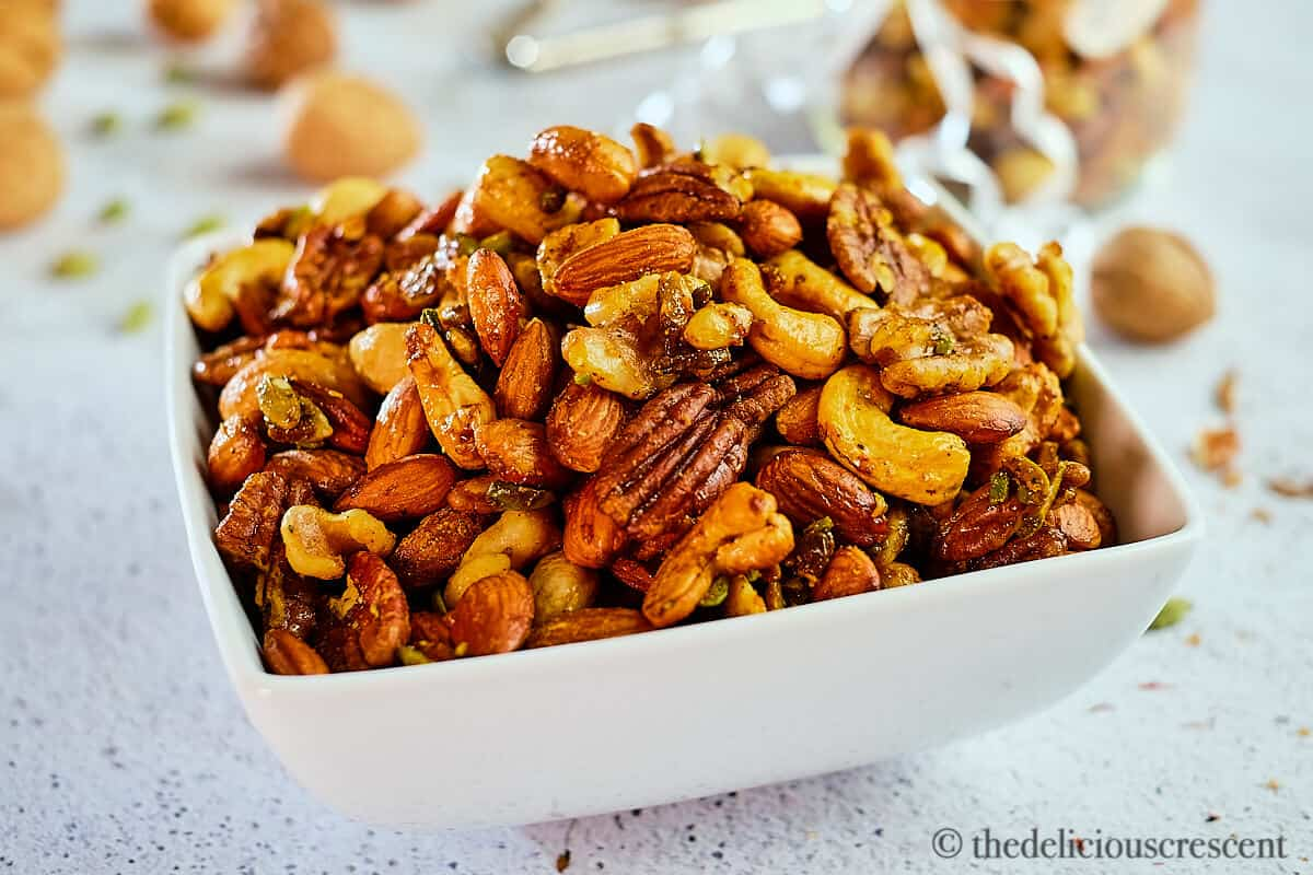A bowl full with nuts roasted with cardamon, saffron and maple syrup.