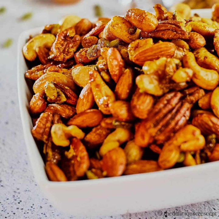 A bowl of sweet and savory roasted party nuts.