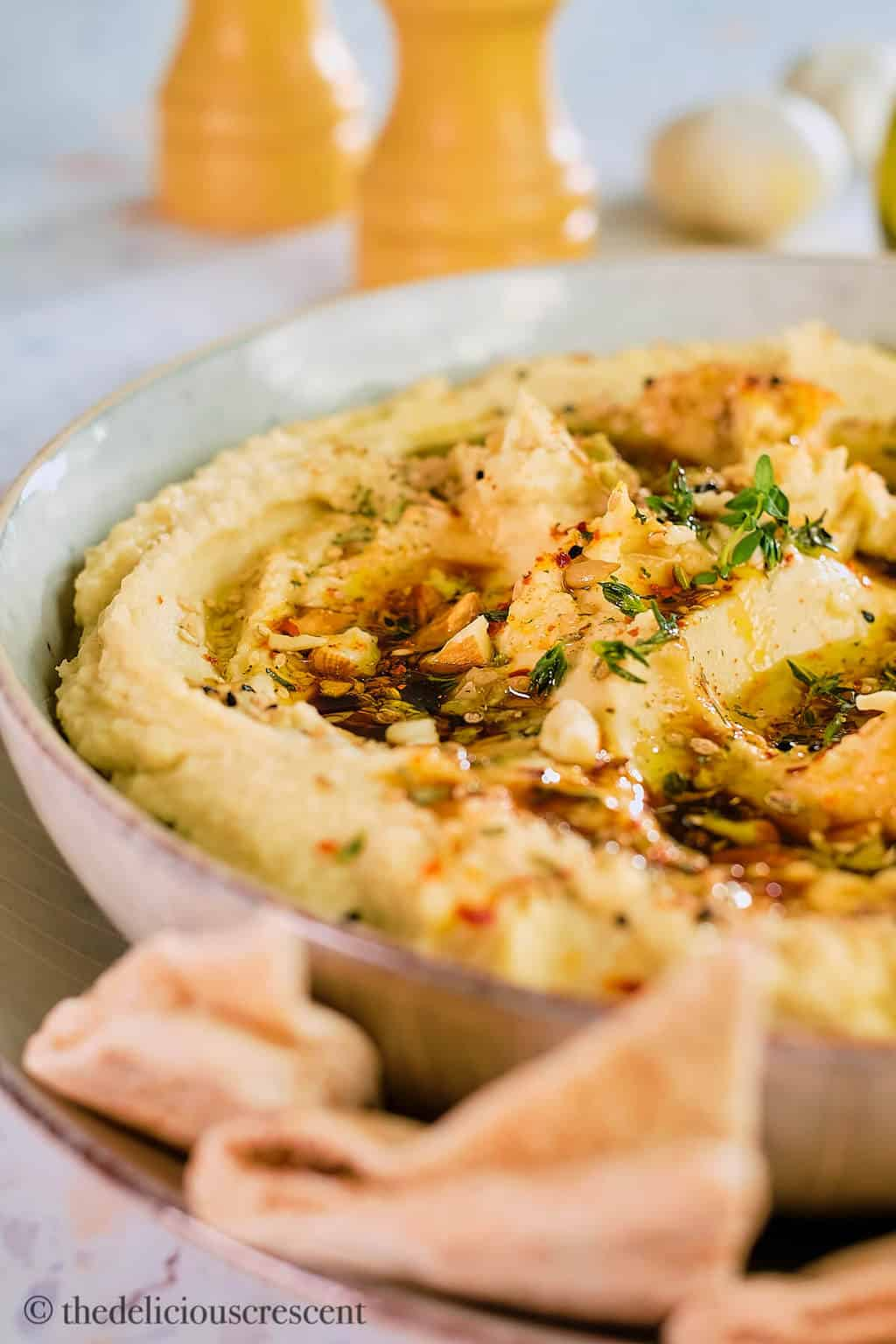 Close up view of butter bean dip in a bowl.