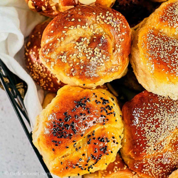 Soft honey wheat rolls served in a basket.