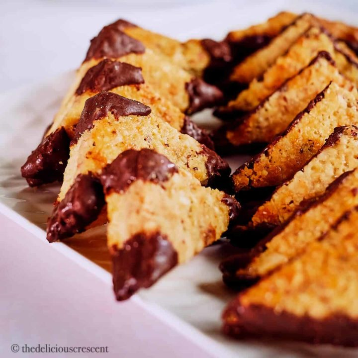 Nussecken, the German chocolate hazelnut bar cookies served on a plate.