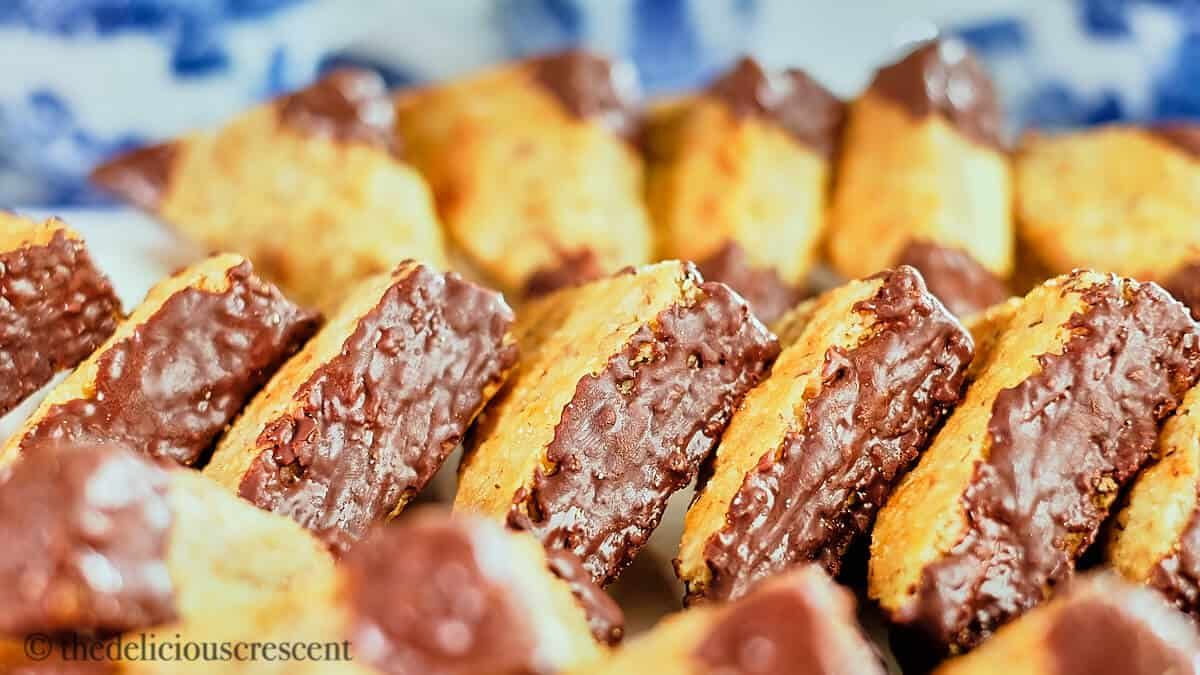 A side view of a stack of chocolate hazelnut bar cookies.