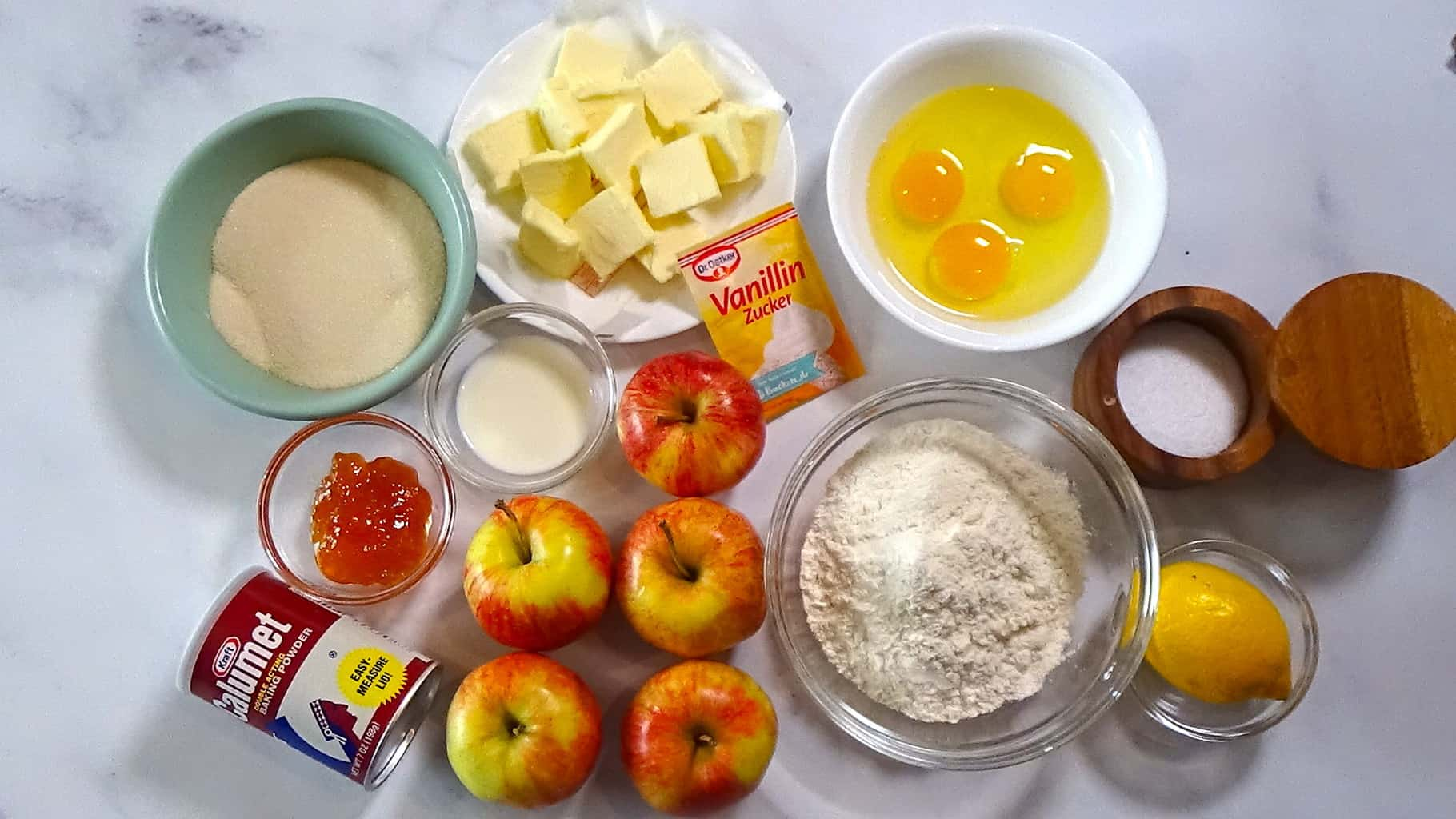 Ingredients needed to make the cake placed together.