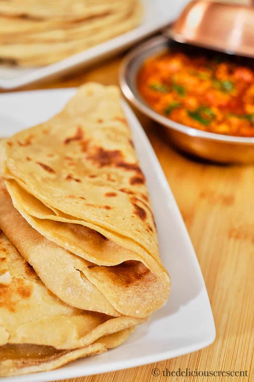 Folded paratha placed on a plate.