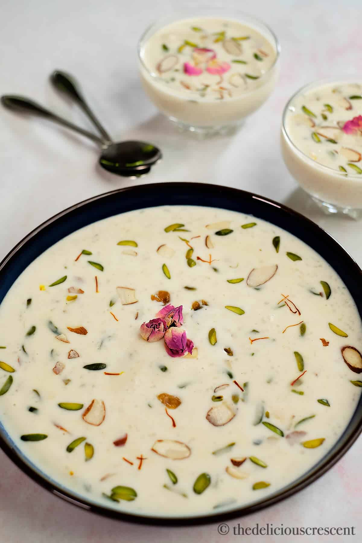 A bowl of rice kheer placed on a table.