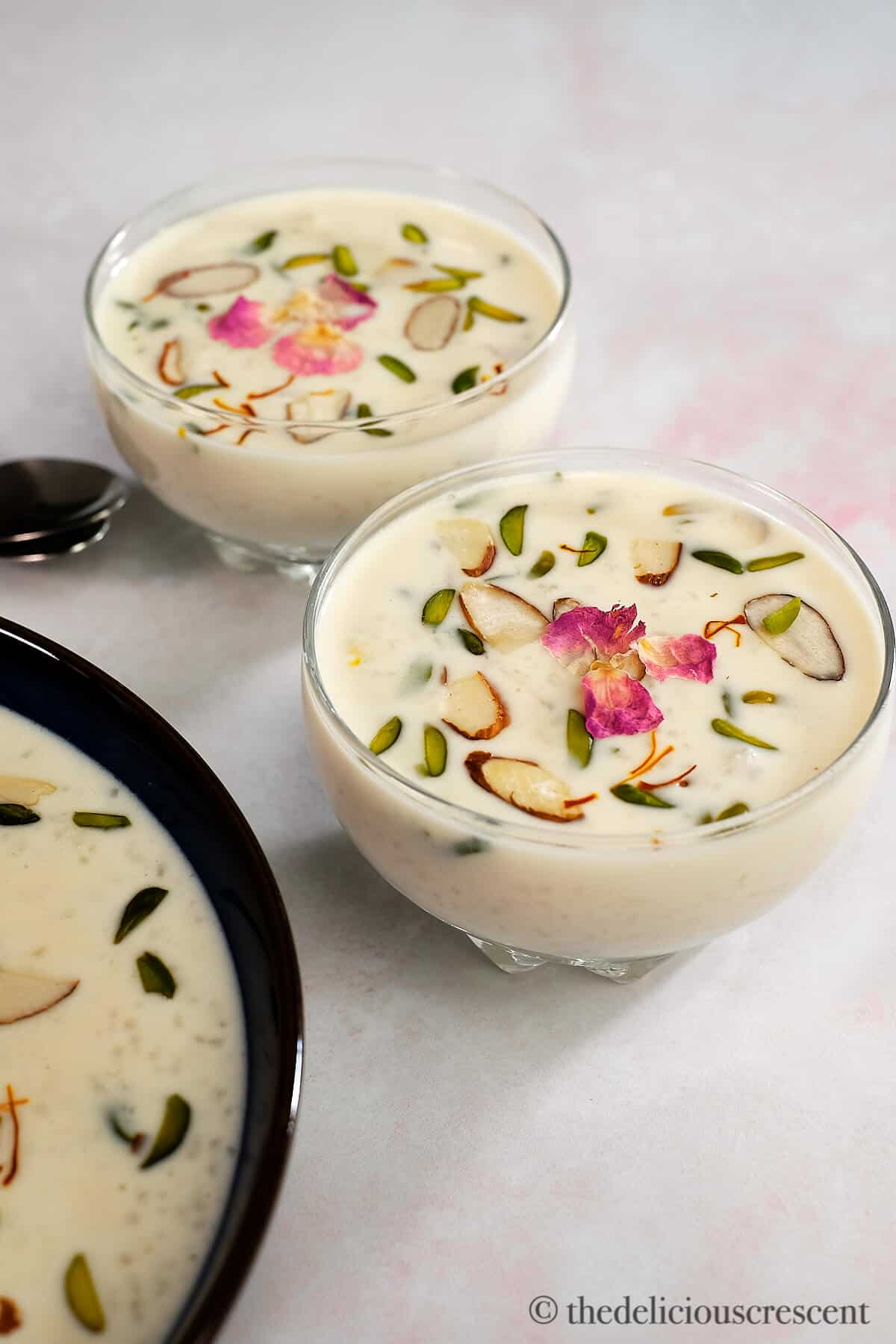Indian rice pudding in two small bowls.