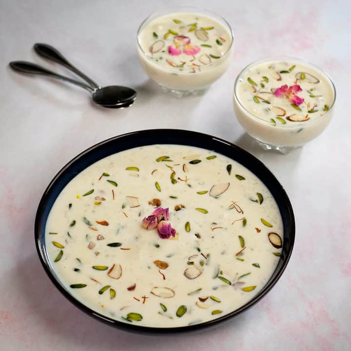 Rice kheer served in a large bowl and two small bowls.