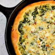 Spinach and feta cheese pizza made in cast iron skillet.