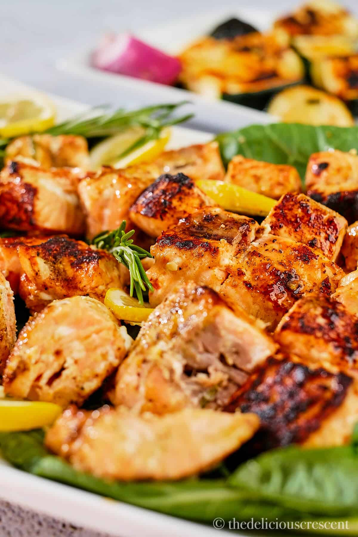 Grilled salmon kabobs arranged on a platter.