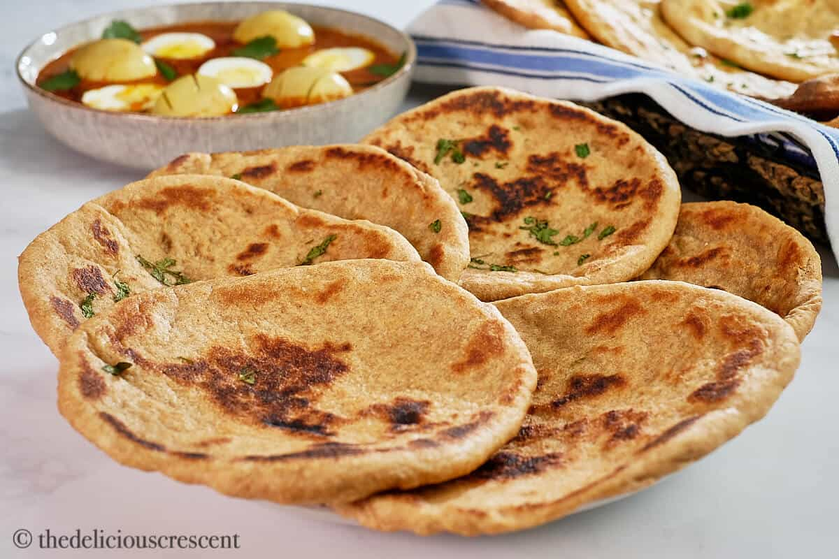 A stack of healthy naans in a plate.