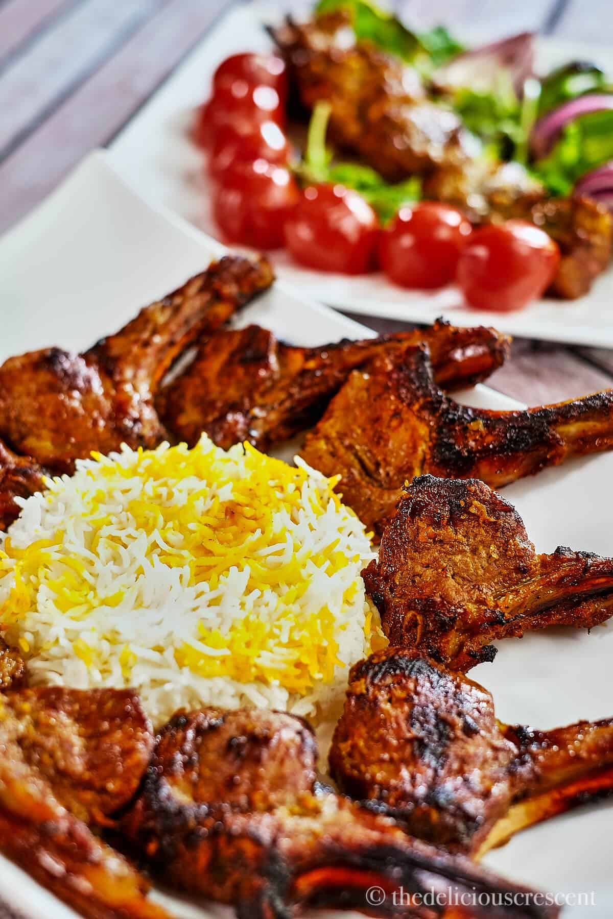 Grilled lamb chops served around saffron rice.