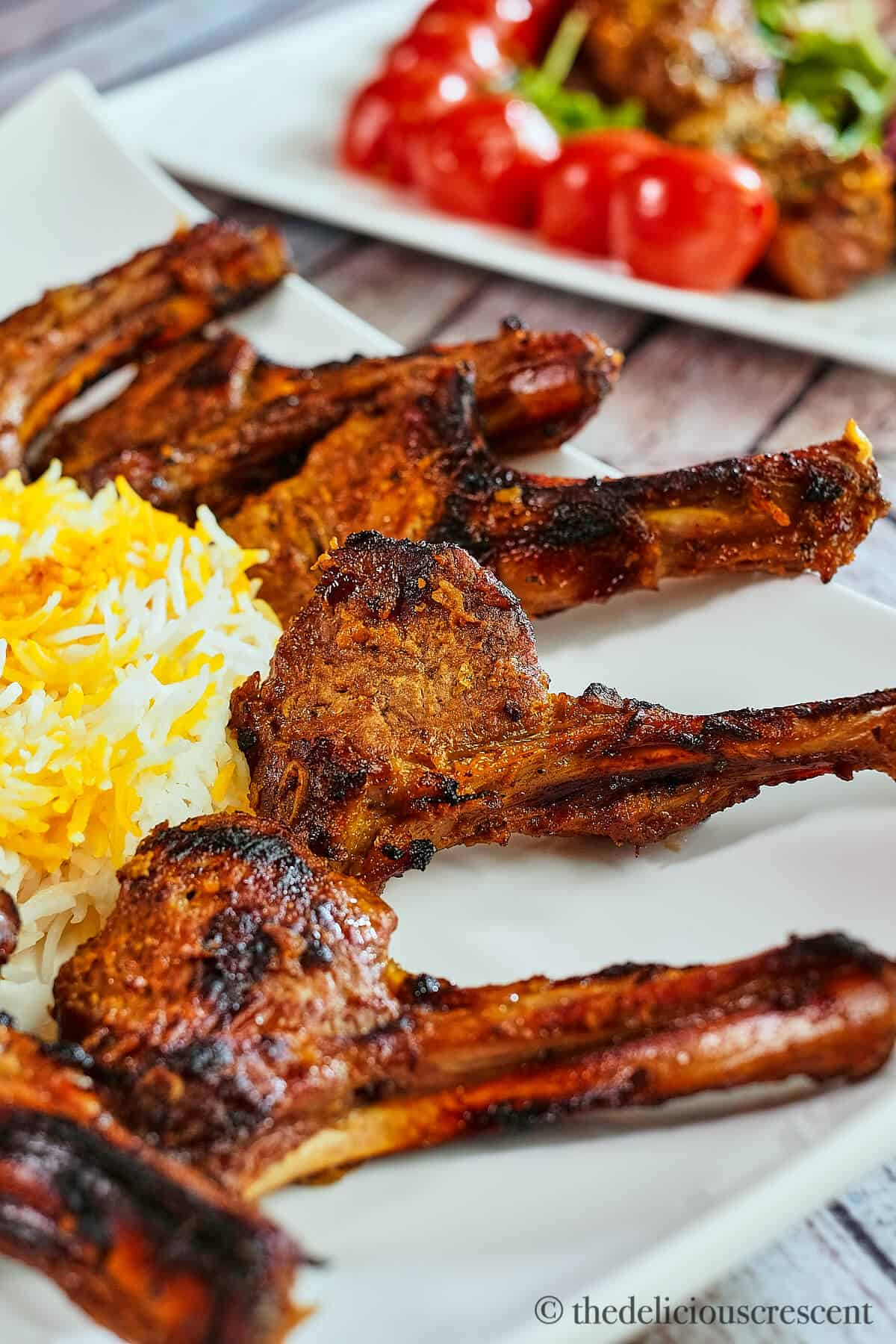 Persian style lamb rib chops with rice.