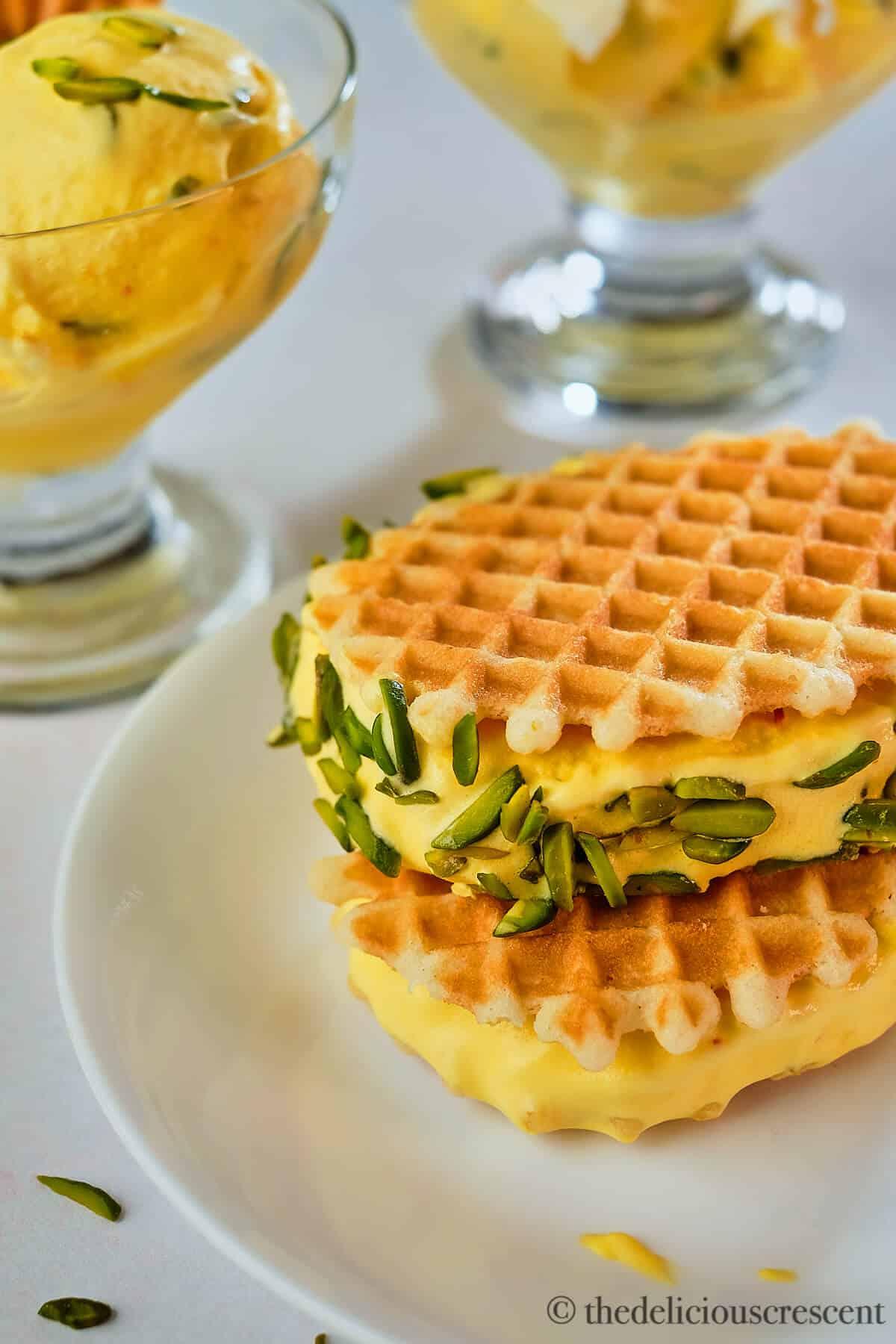 Saffron ice cream sandwich with pistachios.