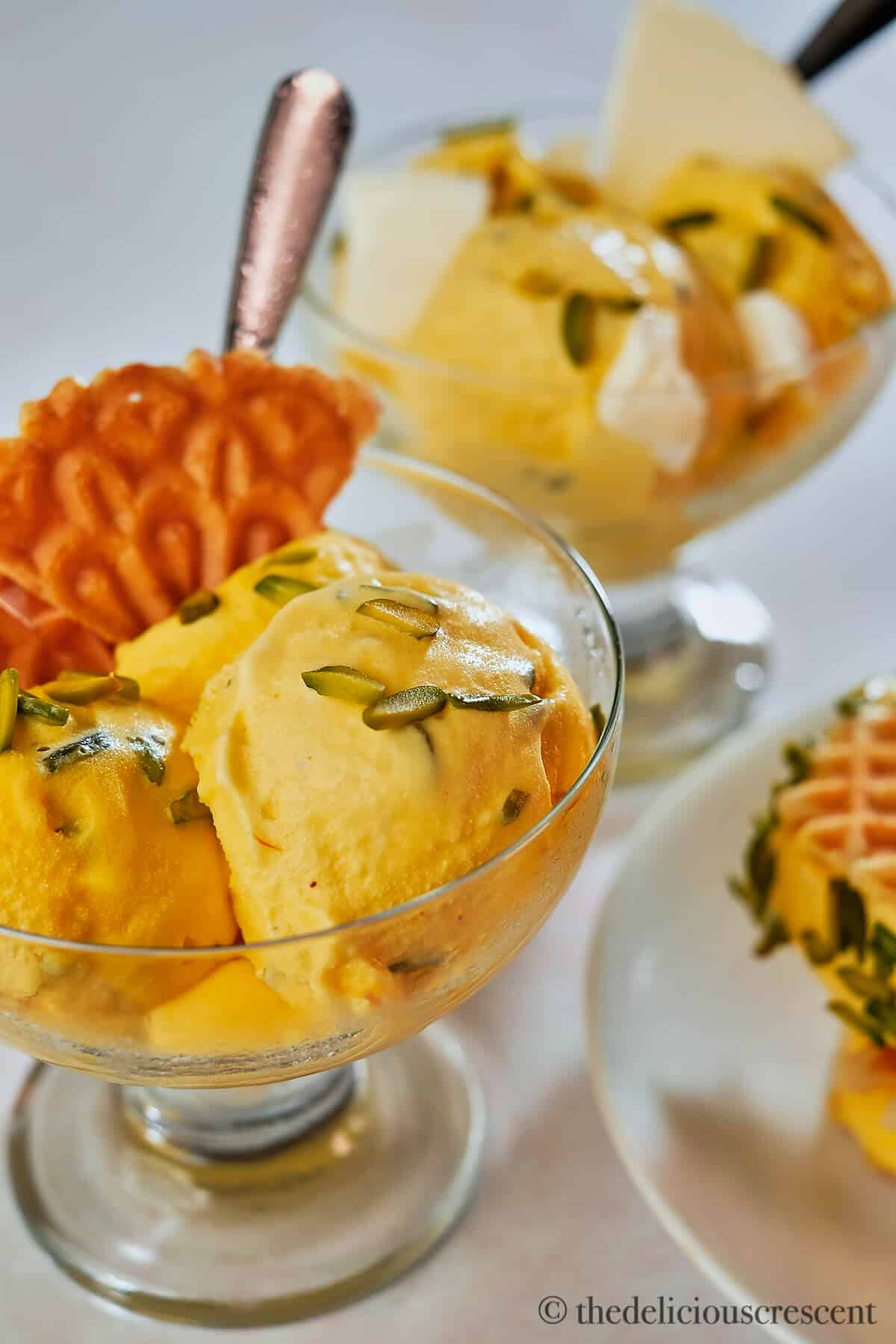 Saffron Ice Cream in a glass cup with waffles.