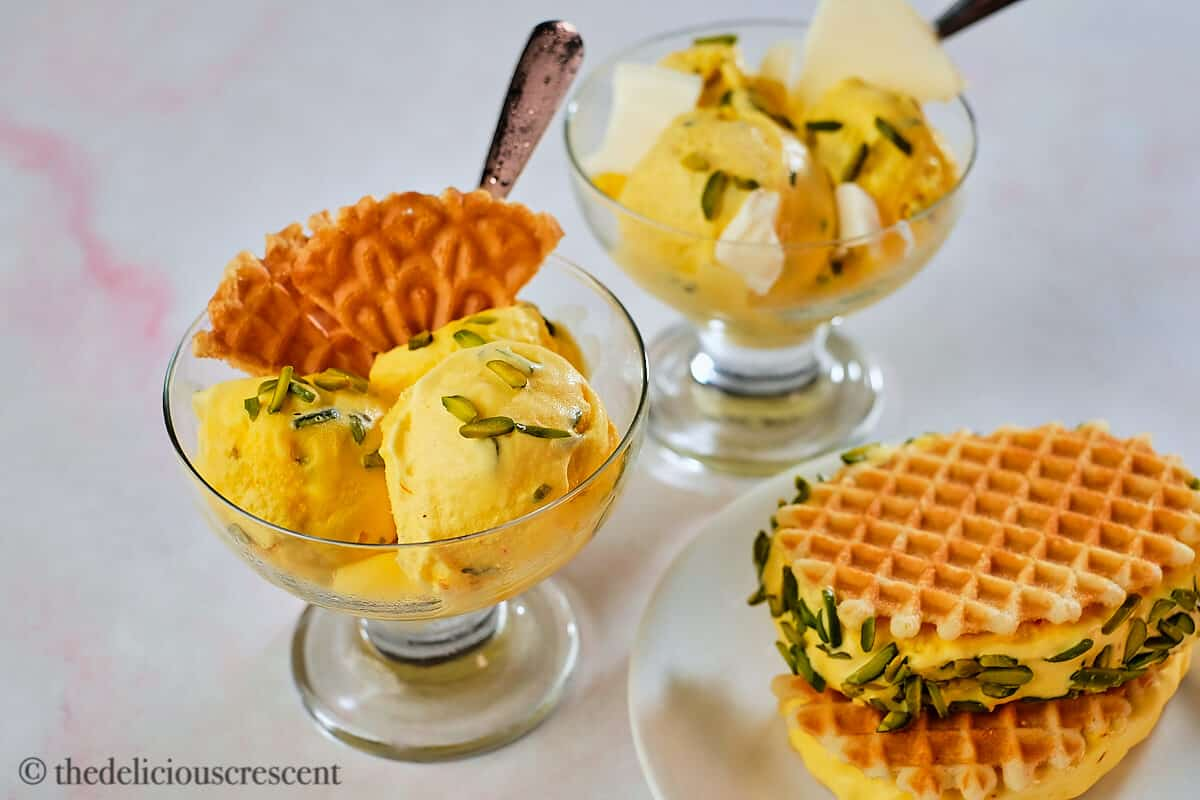 Persian ice cream as scoops and as waffle sandwich.