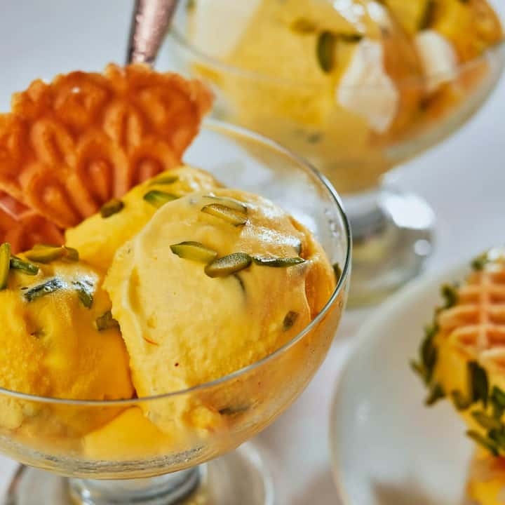 Saffron and rose water ice cream topped with pistachios.