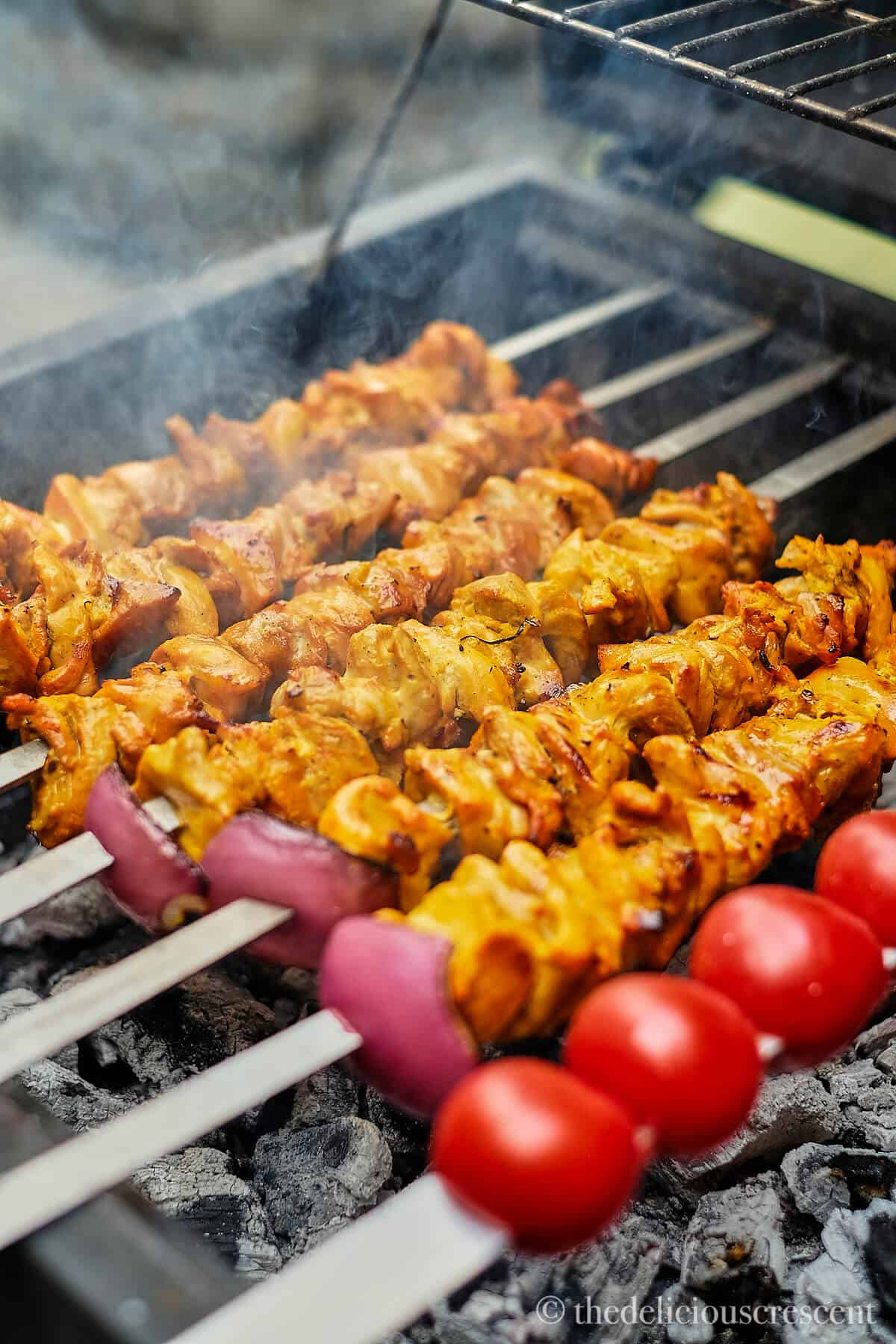 Persian grilled chicken kabobs on skewers.