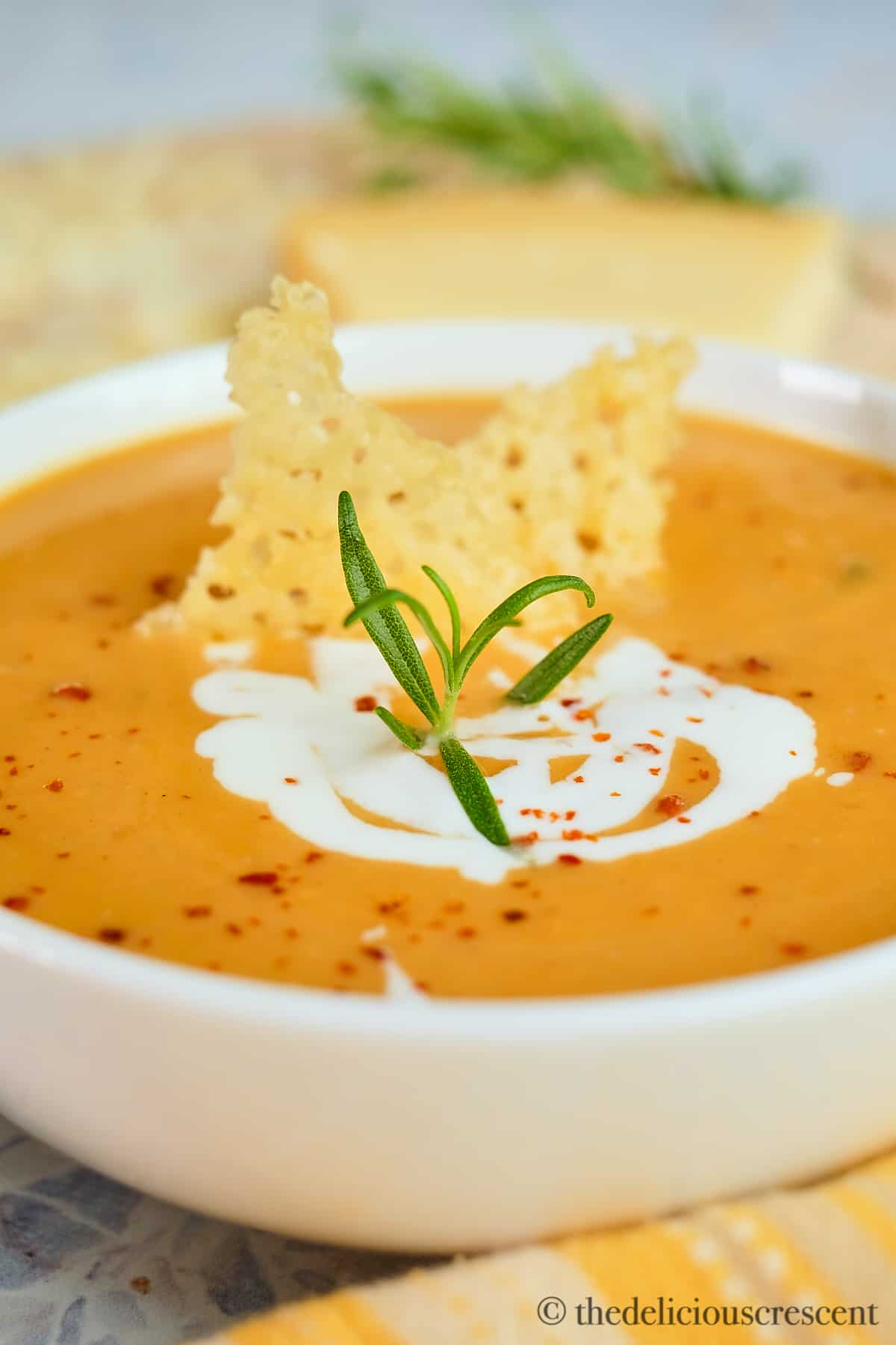 Sweet potato soup made with coconut milk and topped with parmesan crisps.