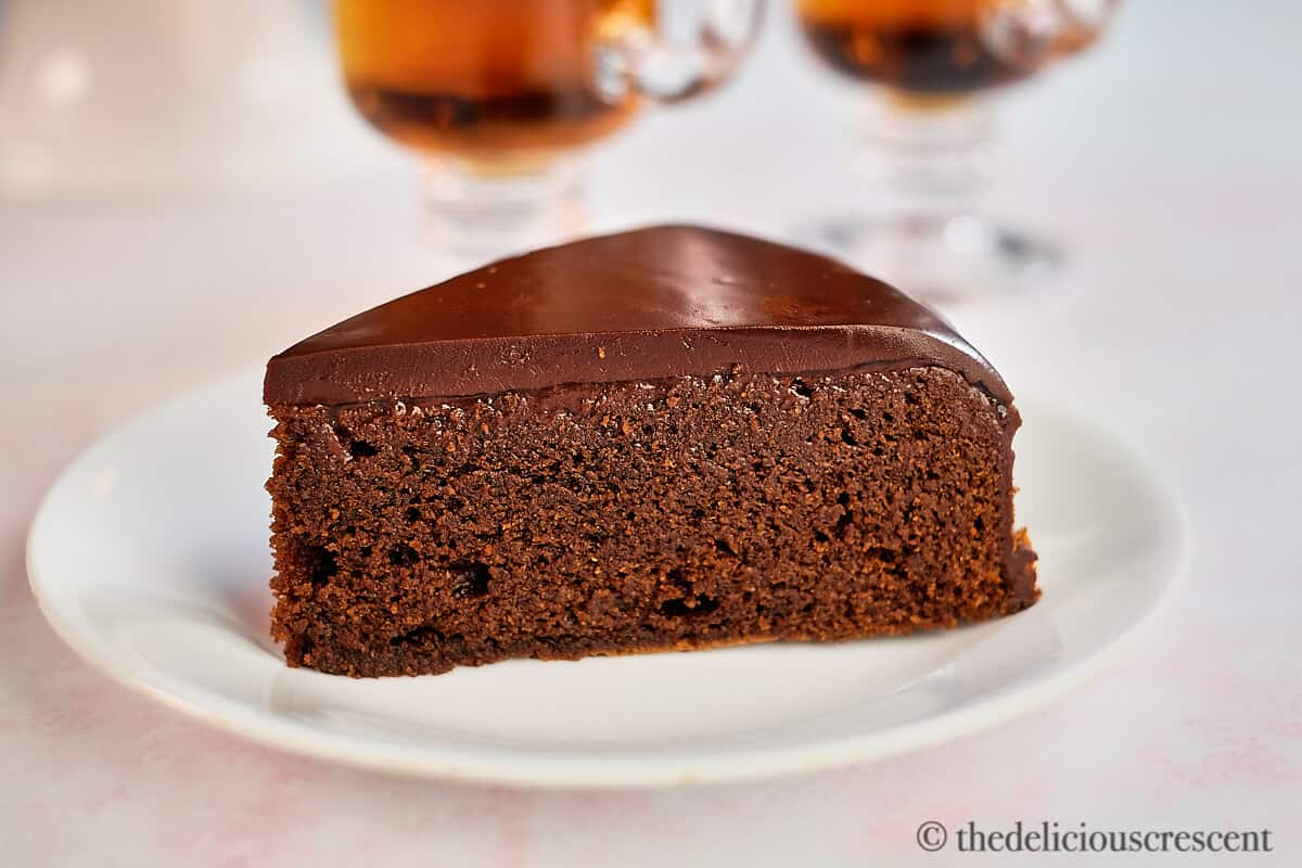 Close up view of almond flour chocolate cake wedge.