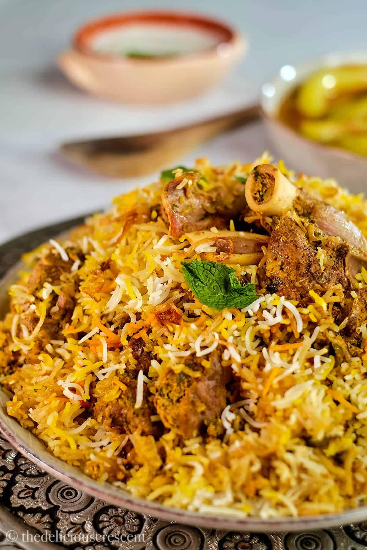 Hyderabadi lamb biryani served in a plate.